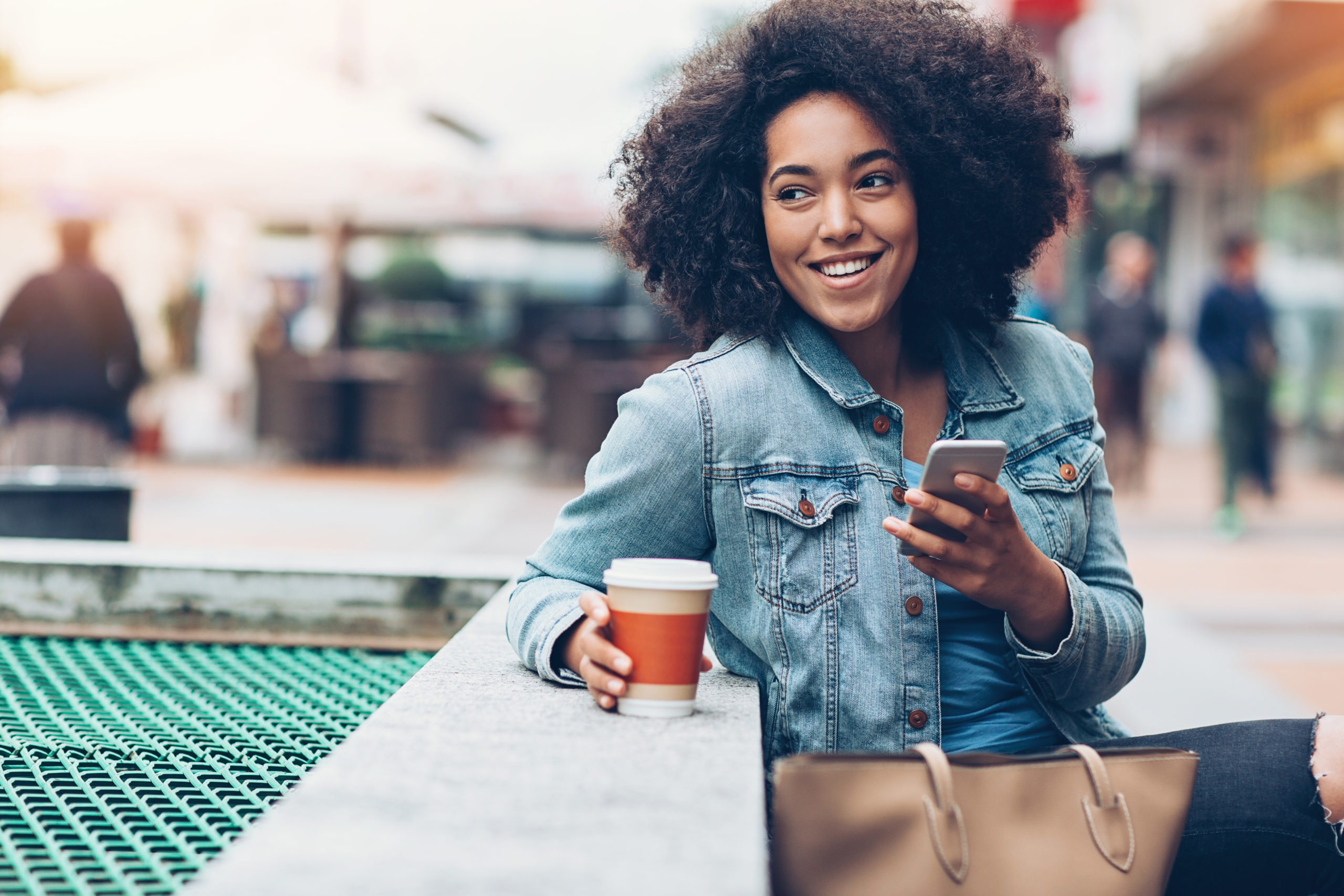 Happy Woman Using Smartphone Outdoors